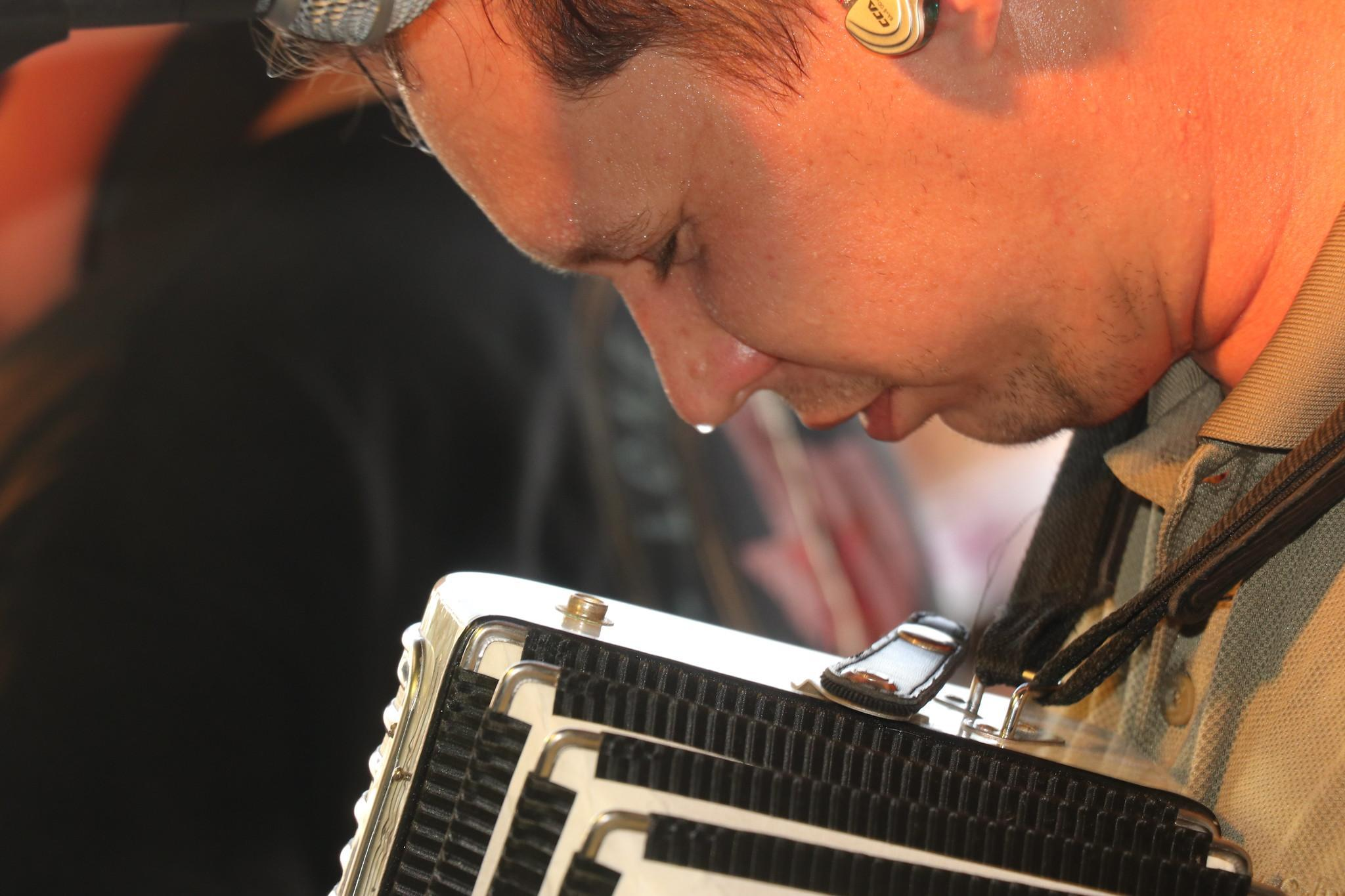 Love this photo of Garrett Neubauer at the Praha Picnic. Gary E. McKee captured this up-and-comer sweatin' to the polkas. No matter how hot it is at the church picnics, I never hear anyone complain. They are just grateful to be there. Amen.