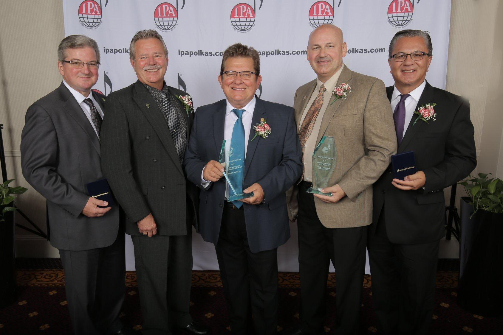 Top row: Lenny Gomulka and the Chicago Push received the award for Favorite Polish-Style Band. Lenny also received the award for Favorite Polish-Style Male Vocalist. Rick Rzeszutko, Jim Sajkowicz, winner of the Leon Kozicki Trustee Award, and Fred Bulinsk