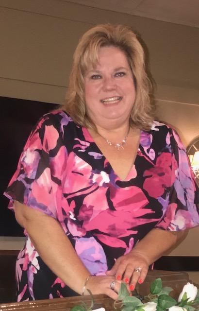 Christy Krawisz, President